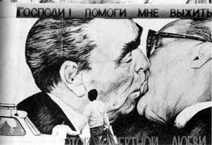 Russian leaders greeting with a presumably platonic kiss.